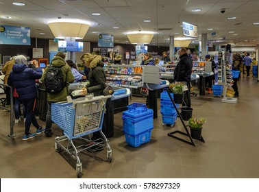 Amsterdam, February 2017. Clients at the cash register paying their purchases at the supermarket