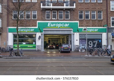 Amsterdam, February 2017. Outside view of a branch of the Europcar car rental company, with cars and clients inside