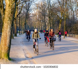 Amsterdam, February 2018. Cyclists in the park on their way to work or school on a sunny winter morning