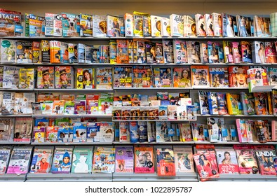 Amsterdam, February 2018. Stand at a news agent's with a large collection of printed magazines