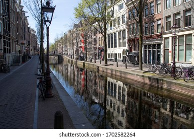 AMSTERDAM, HOLLAND -10 APRIL 2020: The led light district zone (Hookers) Amsteram on the Oudezijdsvoorburg wal is now completely empty. There are no tourists due to the corona covid 19 virus crisis