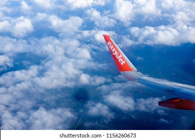 Amsterdam ,Holland - 19.05.2018 View from airplane window on the wing    Plane wing Netherlands