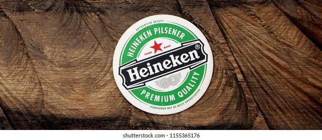 AMSTERDAM, HOLLAND - April 2, 2017.: Beer mats from Heineken Lager Beer in vintage background , it was first brewed by Gerard Adriaan Heineken in 1873