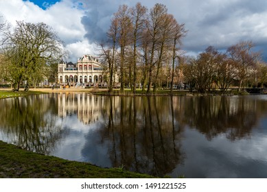 Amsterdam, Holland, August 2019 View over the water in Amsterdam Vondelpark during autumn on a bright day reflecting trees in the water