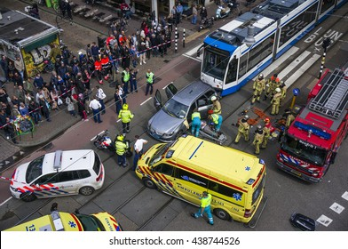Amsterdam, Holland, August 26, 2014: Birds-eye view of emergency services, police, fire brigade and ambulance at the scene of a traffic accident between a tram and a car