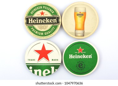 AMSTERDAM, HOLLAND - JANUARY 2, 2018.: Beer mats from Heineken Lager Beer on white background , it was first brewed by Gerard Adriaan Heineken in 1873