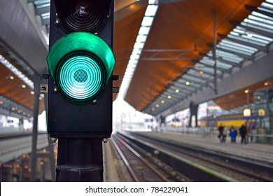 AMSTERDAM, HOLLAND - JANUARY 7, 2017 - Green light (green aspect) railway signal (semaphore) with blurred tracks of Amsterdam metro at Amsterdam Bijlmer Arena station