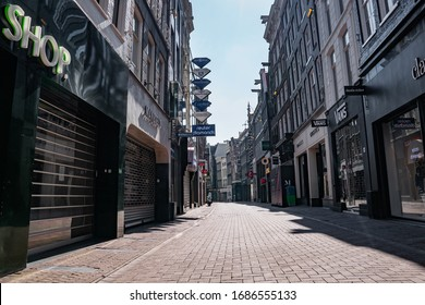 Amsterdam / Holland - March 28, 2020: Deserted Kalverstraat, Amsterdam's most famous shopping street, during corona crisis