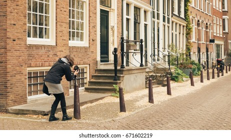 AMSTERDAM, HOLLAND - May 10 2017: woman photographer on the street.