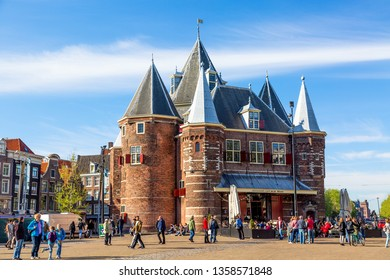 Amsterdam, Holland - May, 2018: De Waag medieval building on Nieuwmarkt square or New Market square with blue sky,