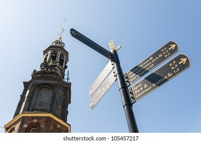 AMSTERDAM, HOLLAND - MAY 27: Sign post with Western Church spire in the background. May 27, 2012 in Amsterdam. The  spire is the tallest in Amsterdam, with 85 meters.