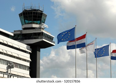 AMSTERDAM, HOLLAND, NETHERLANDS - AUGUST 18, 2007: Control tower and flags, at Schiphol airport