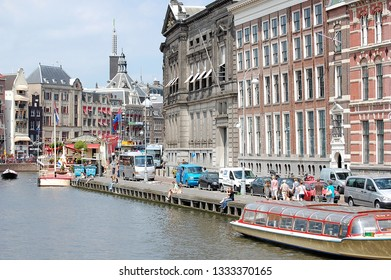 AMSTERDAM, HOLLAND — NETHERLANDS — JUNE 26, 2010:  Cityscape of Amsterdam, the capital city of the Netherlands