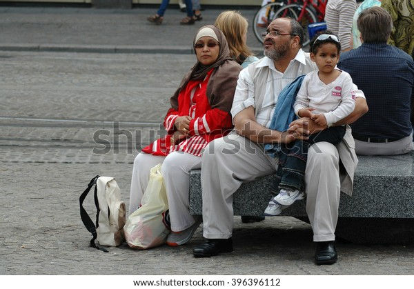 AMSTERDAM, HOLLAND - SEPTEMBER 03, 2005: Muslim family resting on the street