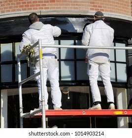 AMSTERDAM, HOLLAND-FEBRUARY 5:Two painters working outside at a scaffold.February 5, 2015 Amsterdam, Holland