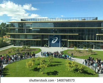 Amsterdam, Hoofdorp, the Netherlands - May 14th 2019: Aerial view on ASICS employees evacuated outside new office building in Hoofdorp during fire drills evacuation