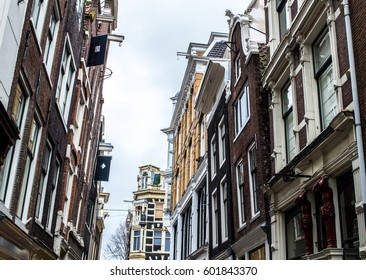 Amsterdam houses are leaning forward, they tilt to one side and some look like they might fall over./ Amsterdam houses crooked