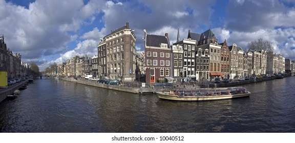 Amsterdam innercity with cruiseboat in canal in the Netherlands