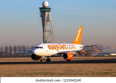 AMSTERDAM - JAN 16, 2012: EasyJet Airlines Airbus A319 airliner plane taking off from Amsterdam Schiphol international airport.