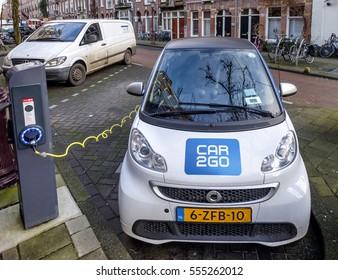Amsterdam, January 2017. Electrical car from the Car2Go car sharing service, plugged into a battery charging station