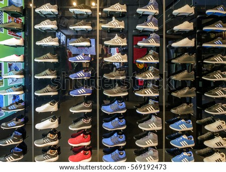 e76ff6560b4 Amsterdam, January 2017. lots of Adidas sneakers on display in a shop