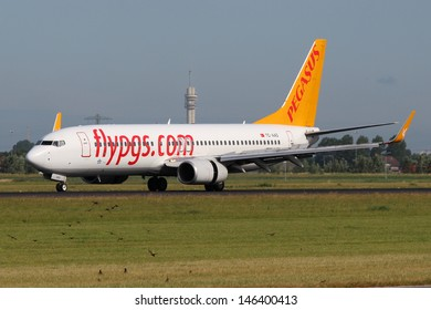 AMSTERDAM - JULY 02: Pegasus Airlines Boeing 737-86N lands at AMS Airport in Netherlands on July 02, 2012. Pegasus Airlines is a low-cost airline of Turkey.