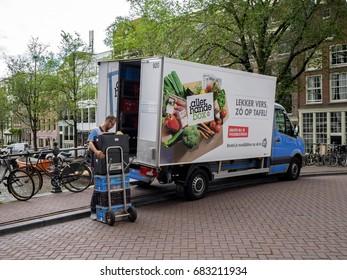 Amsterdam, July 2017. Delivery van of Albert Heijn supermarket company delivering groceries