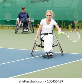 AMSTERDAM - JULY 21: Unidentified athletes participate in Amsterdam Open Wheelchair Tennis competition, held on July 21, 2012 in Amsterdam,The Netherlands