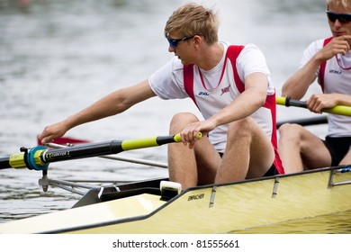 AMSTERDAM - JULY 23:  Holmemo (Norway BM4-) adjusts the riggers, prior to the start of the Finals during the world championships rowing. On July 22, 2011 in Bosbaan, Amsterdam, The Netherlands