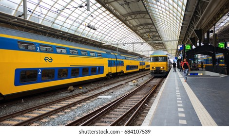 AMSTERDAM - JULY 25: Dutch Nederlandse Spoorwegen train departing from Amsterdam Station on July 25, 2017 in Amsterdam, The Netherlands. Nederlandse Spoorwegen company operates 4,800 trains a day.