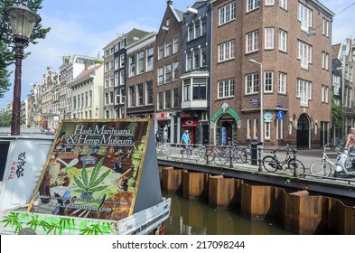 AMSTERDAM - JULY 26: Advertising Hash Marijuana & Hemp Museum marijuana with the canal and old buildings in the background on 26 July 2014 in Amsterdam, The Netherlands. The museum was opened in 1985.