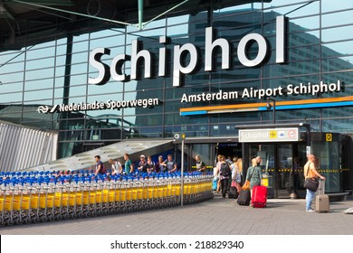 AMSTERDAM - JULY 31: Main entrance to Schiphol Airport on July 31, 2014 in Amsterdam, Netherlands. The airport handles over 45 million passengers per year with almost 100 airlines flying from here.