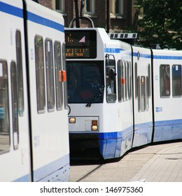 AMSTERDAM - JUNE 21 : Tram running in the city centre on June 21, 2010, Amsterdam, Netherlands. The tram network comprises 16 different lines with a total length of 213 km.