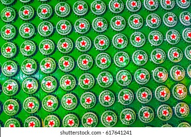 AMSTERDAM - March 4, 2006: Closeup of a large display of Heineken beer bottle caps.