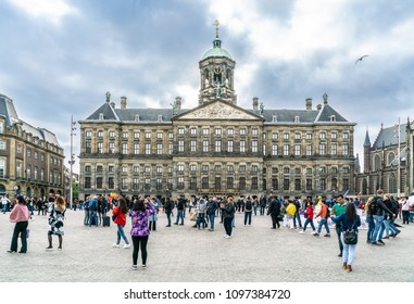 Amsterdam May 18 2018 - tourist and locals visiting the Dam square with in the background the old city hall and now the royal palace. Build by Napoleon in the 1800s