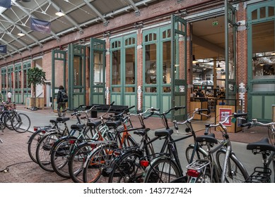 AMSTERDAM, MAY 2, 2019: De Hallen in Amsterdam, restaurants, bars and small shops in the former tram depot De Hallen are very popular place in Amsterdam. Netherlands.