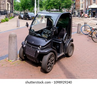 Amsterdam, may 2018. Estrima Biro electric vehicle parked on the sidewalk in the city