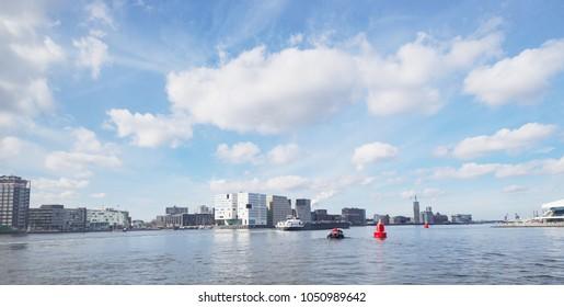 Amsterdam modern water canal of  Haarlemmerbuurt Westelijke Eilanden cityscap skyline
