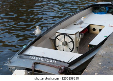 Amsterdam named motor boat in a city canal