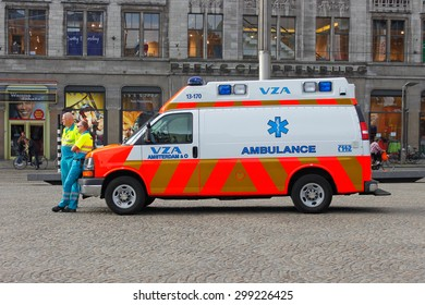 AMSTERDAM, NEDERLANDS - SEPTEMBER 12, 2011: Two paramedics hear their ambulance car Chevrolet at the city square.