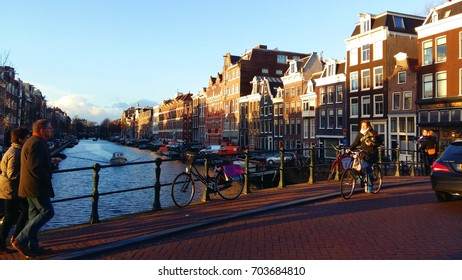 AMSTERDAM, NETHER LAND on 16 January 2016 - Background view of bicycle parking on next to the iron rail on the bridge