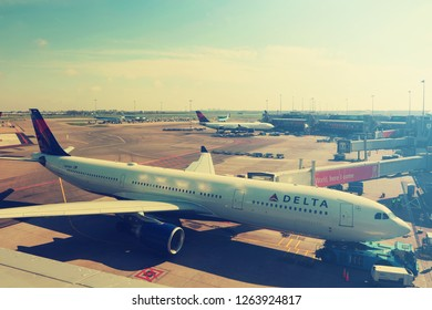 AMSTERDAM, NETHERLADS - on April 17, 2017: Schiphol international airport. Planes of KLM Royal Dutch Airlines and Delta Airlines, USA on parking. Other aircrafts are towed to  runway on the airfield
