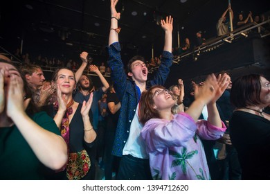 Amsterdam, The Netherland - 06 March 2019: audience cheering during concert of Congolese band KOKOKO! at Paradiso Noord Tolhuistuin in Amsterdam