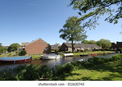 AMSTERDAM, NETHERLAND 11 MAY 2014 : Contemporary looking house alongside a canal in Amsterdam.
