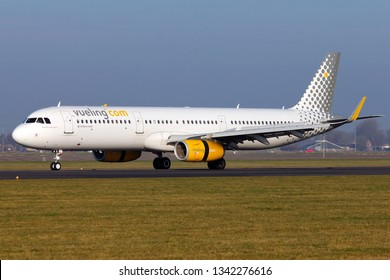 AMSTERDAM, NETHERLAND - FEBRUARY 23, 2019 - Vueling Airbus 321 landing in Amsterdam Schiphol Airport