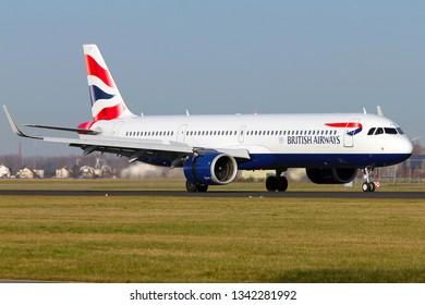 AMSTERDAM, NETHERLAND - FEBRUARY 24, 2019 - British Airways Airbus 321 NEO landing in Amsterdam Schiphol Airport