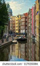 Amsterdam, Netherland - July 7, 2018: Beautiful view of Amsterdam canals with bridge and typical dutch houses. Holland