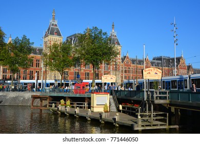 AMSTERDAM NETHERLAND OCTOBER 03 2015 Station Amsterdam Centraal is the largest railway station of Amsterdam, Netherlands, and a major national railway hub. Used by 260,000 passengers a day.