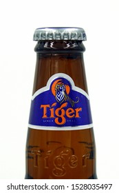 Amsterdam, the Netherland - October 9, 2019: Bottleneck of a Tiger Beer bottle.
