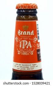 Amsterdam, the Netherland - October 9, 2019: Bottleneck of a Brand IPA beer bottle.